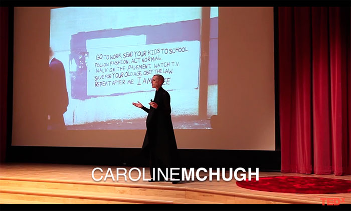 Caroline McHugh speaking on stage at TED