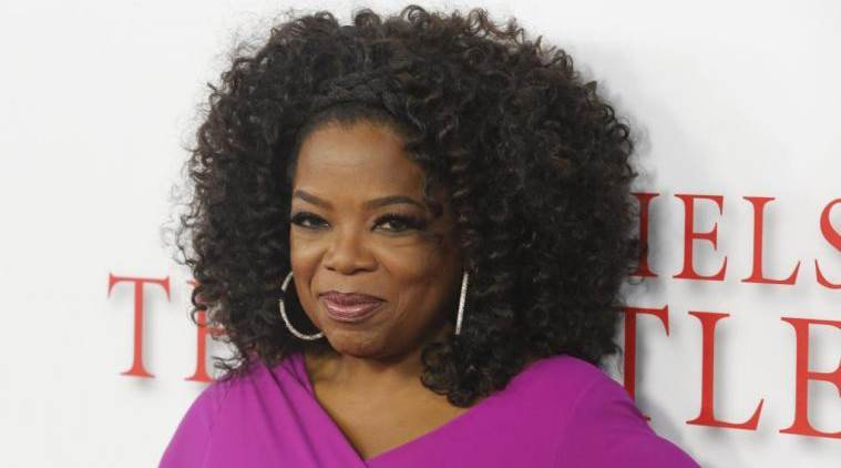 "Actress Oprah Winfrey, a cast member of the film ""Lee Daniels' The Butler"", poses at the film's premiere in Los Angeles August 12, 2013. REUTERS/Fred Prouser (UNITED STATES - Tags: ENTERTAINMENT)"